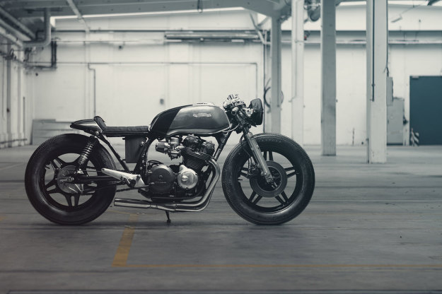 A dark, low-slung Honda CB750 customized by Hookie Co of Germany.