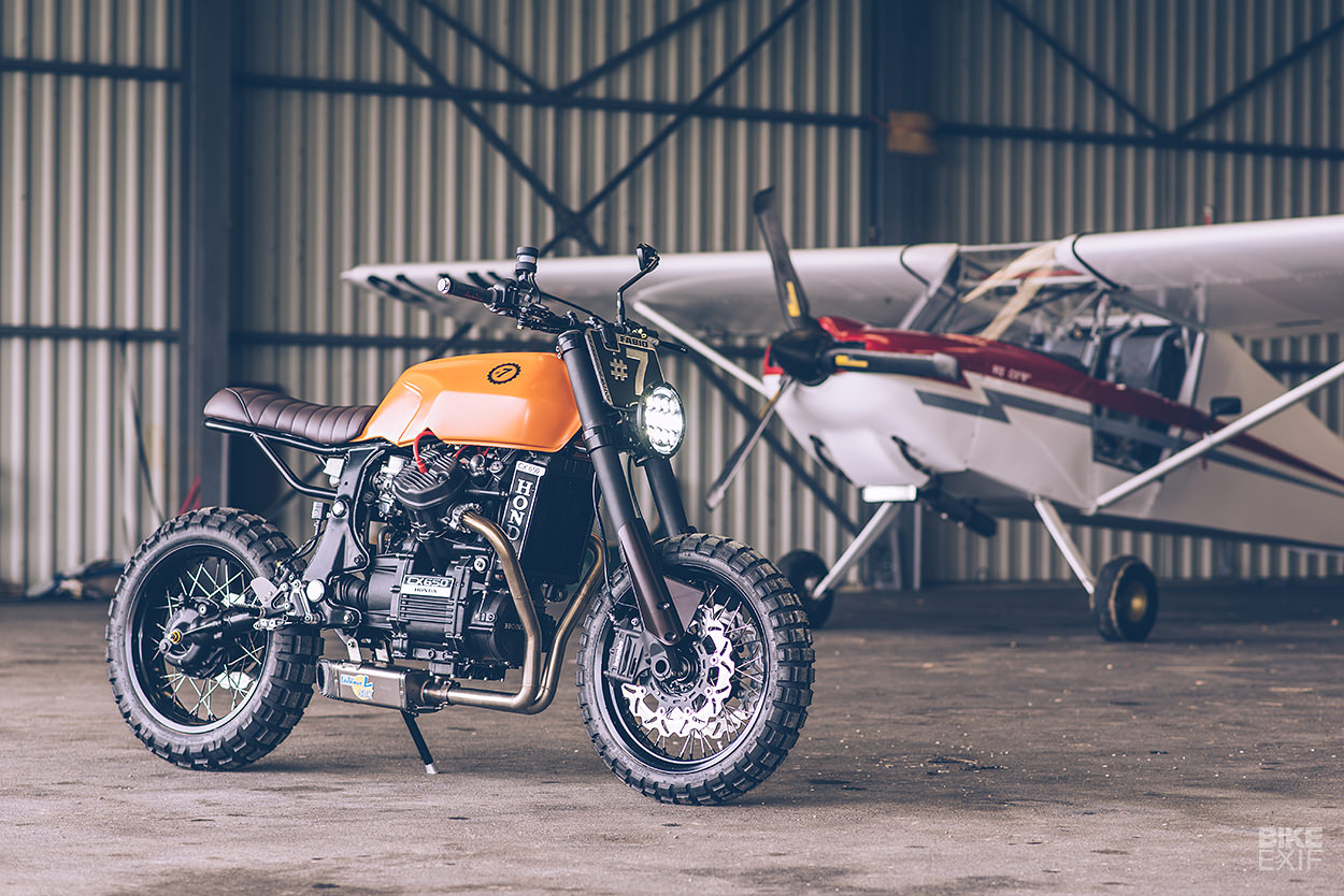 A heavily customized Honda CX650 scrambler built by Freeride fora former supermoto racer