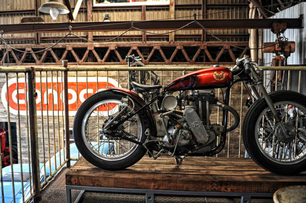 A customized Matchless motorcycle inside the Japanese workshop Heiwa.