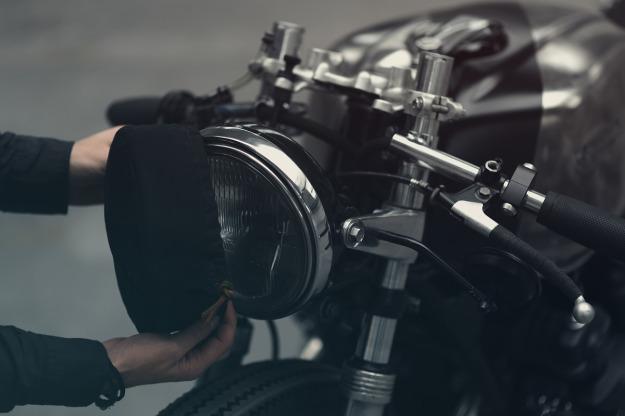 A dark, low-slung Honda CB750 customized by Hookie Co of Germany.