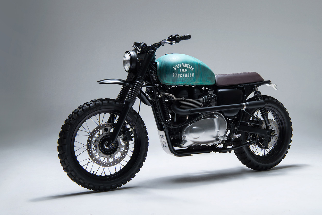 A 2010 Triumph Bonneville given the hardcore scrambler treatment by 6/5/4 Motors.