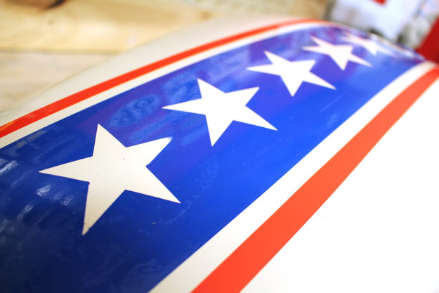 Painting a motorcycle tank with Stars and Stripes