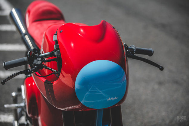 Red Hot: DeBolex deliberately left off a headlight, tail light or turn signals, to maximize the race vibe of the bike. But it is 'daytime' street legal in the UK, so hopefully it'll get out regularly.  A custom Ducati Scrambler from deBolex Engineering
